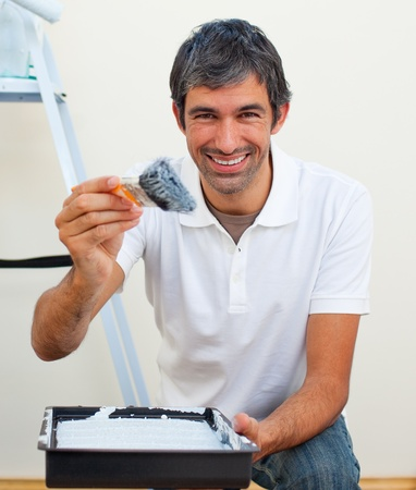 man painting: Attractive man painting a wall  Stock Photo
