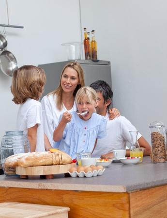 Jolly family having breakfast photo