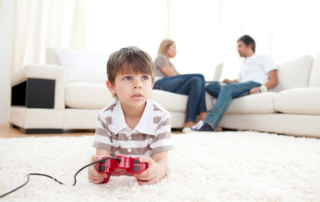Cute little boy playing video games photo