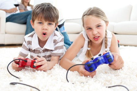 Animated children playing video games Stock Photo - 10096028