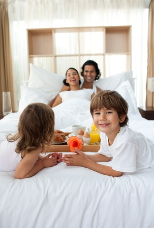 Happy children bringing a breakfast to their parents  Stock Photo - 10097162