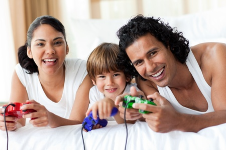 Boy and his parents playing video games photo