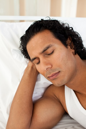 Attractive man sleeping on the bed photo
