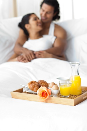 Smiling lovers having breakfast on the bed  Stock Photo - 10095863