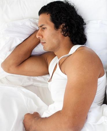 Upset man sleeping separately of his girlfriend Stock Photo - 10095425