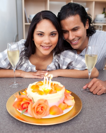 Attractive woman celebrating her birthday with her husband photo