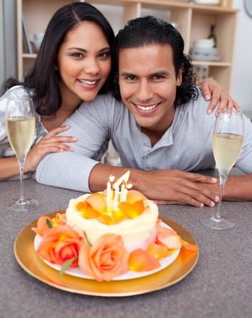 Elegant man and his wife celebrating his birthday photo
