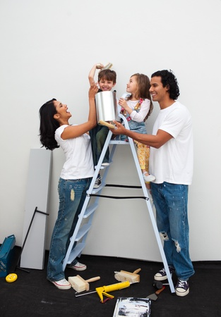 Happy family painting a room  photo