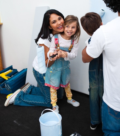 Portrait of little girl painting with her mother Stock Photo - 10097316