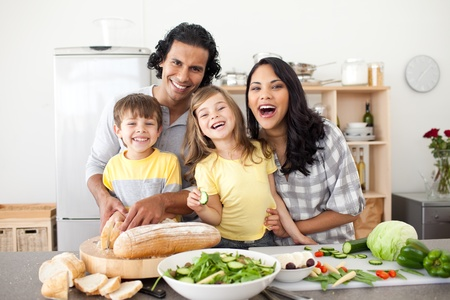 Lively family having fun in the kitchen photo
