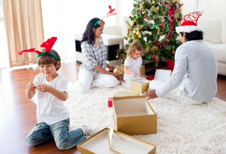 Family playing with Christmas gifts at home Stock Photo - 10096776