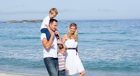 Lively family walking on the sand  photo