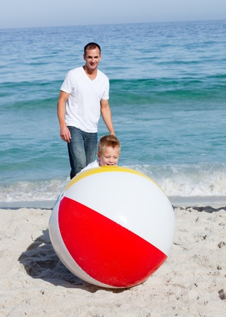 Animated father and his son playing with a ball  photo