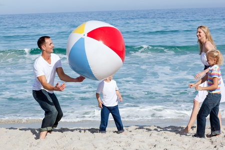 Lively family playing with a ball  photo