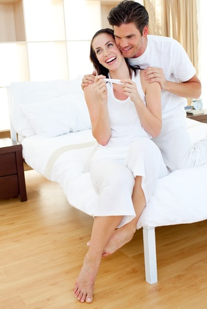 finding out: Joyful couple finding out results of a pregnancy test