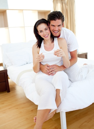 Jolly couple finding out results of a pregnancy test Stock Photo - 10096891