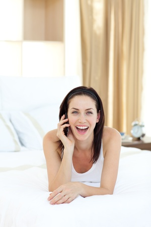 Smiling woman talking on phone photo