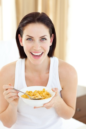 Beautiful woman having breakfast photo