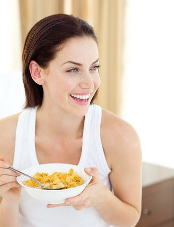 Positive woman having breakfast photo
