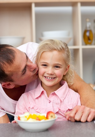 Caring father eating fruit with his daughter Stock Photo - 10105829