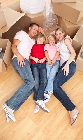 Smiling family while moving house photo