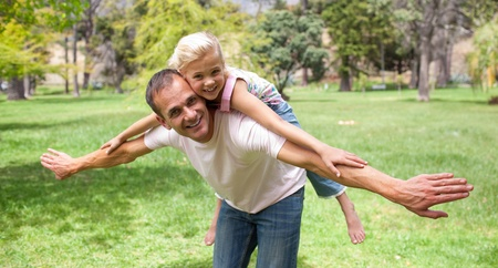 Adorable little girl having fun with her father  photo