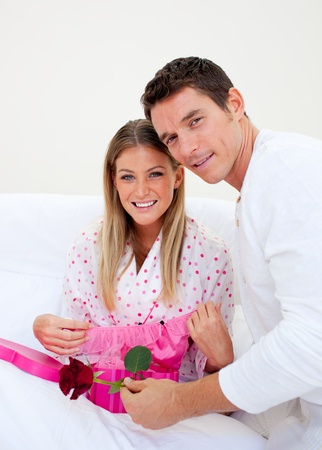 gstring: Elegant husband giving a present to his wife Stock Photo