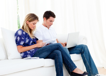 Young couple working at home Stock Photo - 10096968