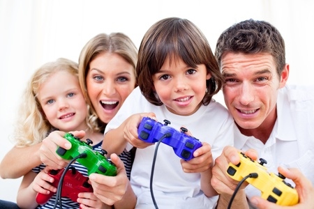 playing a game: Animated family playing video game Stock Photo