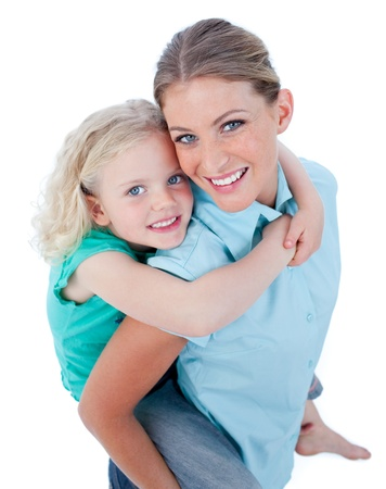 Blond mother giving her daughter piggyback ride photo