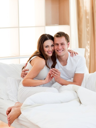 finding out: Romantic couple finding out results of a pregnancy test