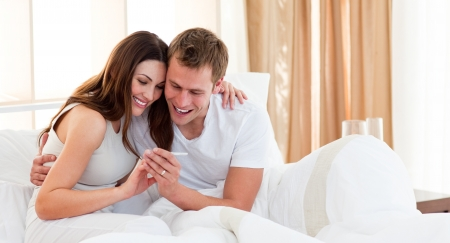 pregnancy test: Affectionate couple finding out results of a pregnancy test Stock Photo