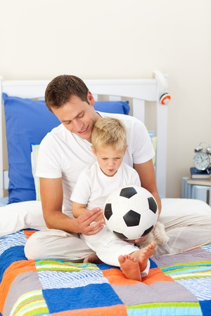 Adorable little boy and his father playing with a soccer ball Stock Photo - 10097270