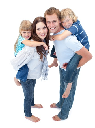 Smiling Family Against A White Background photo