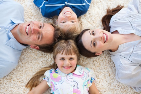 Smiling family lying in a circle photo