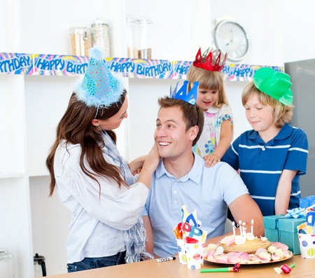 elated: Elated man celebrating his birthday with his wife and his children