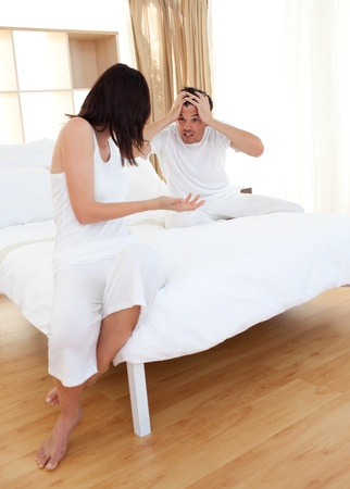 Couple in bedroom having an argument  photo