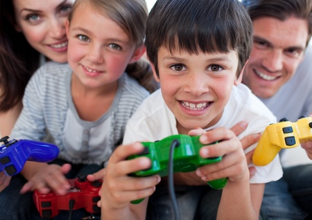 Excited Family playing video games Stock Photo - 10097139