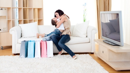 Affectionate mother and her daughter at home after shopping photo