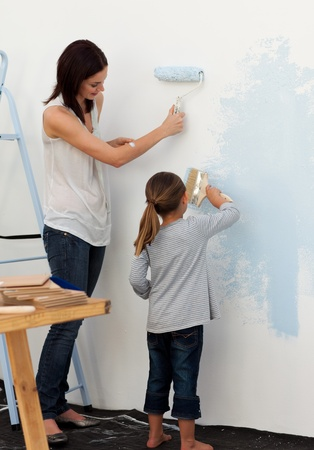 adult wall: Mother and her daughter painting together