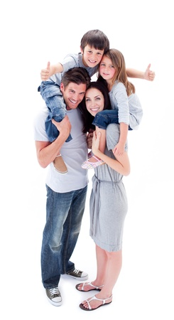 Jolly parents giving their children piggyback ride photo