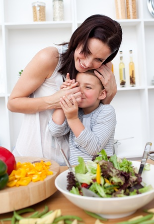 Mother and her little girl having fun in the kitchen photo