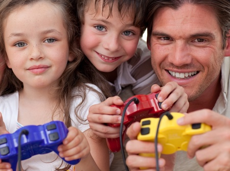 Excited family playing video games photo