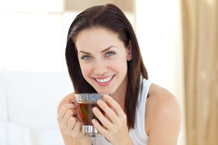 Brunette woman drinking tea  photo