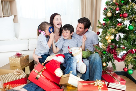 Happy family playing with Christmas gifts photo