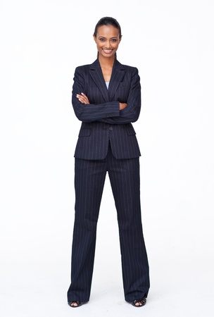 businesswoman standing: Isolated confident Indian businesswoman smiling at the camera