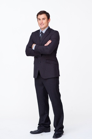 Confident businessman with folded arms against white Stock Photo - 10095693