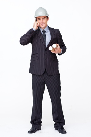 Smiling attractive architect on phone holding plans photo
