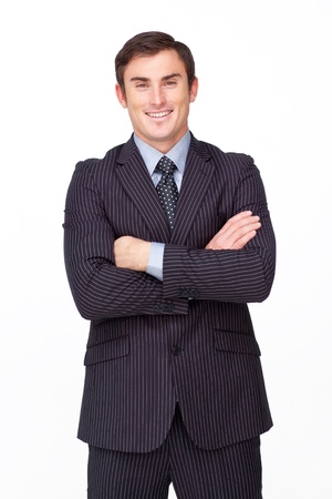 Handsome businessman with folded arms against white Stock Photo - 10096887