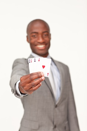 Attractive Afro-American businessman holding four aces photo